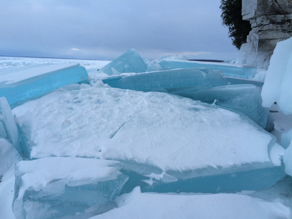 "2 ft. thick slabs of ""glowing"" ice below Door Bluff Headlands County Park"